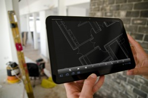 Using a mobile device on-site to make live room changes. Image courtesy of Autodesk, Inc.
